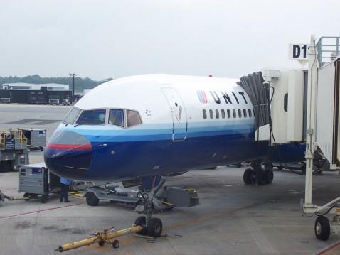 A plane takes on passengers at Baltimore Washington International Thurgood Marshall Airport. Flickr photo courtesy of InSapphoWeTrust.