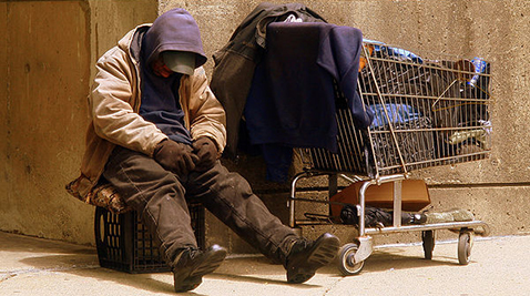 Homeless Veteran on the streets of Boston, MA. Photo courtesy by Matthew Woitunski/ Wikimedia Commons.