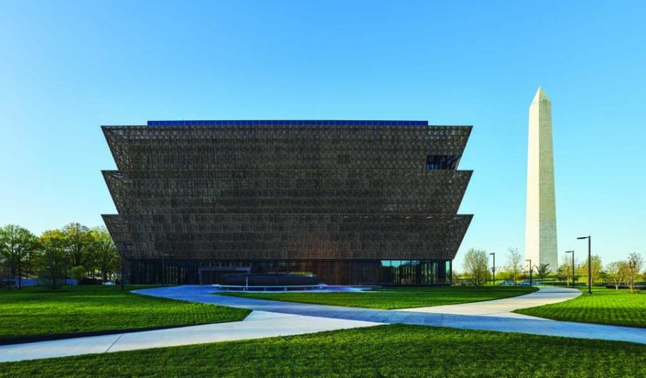Vista of the Museum from Constitution Avenue, looking across the north lawn to the Washington Monument. Photo credit: Alan Karchmer/NMAAHC
