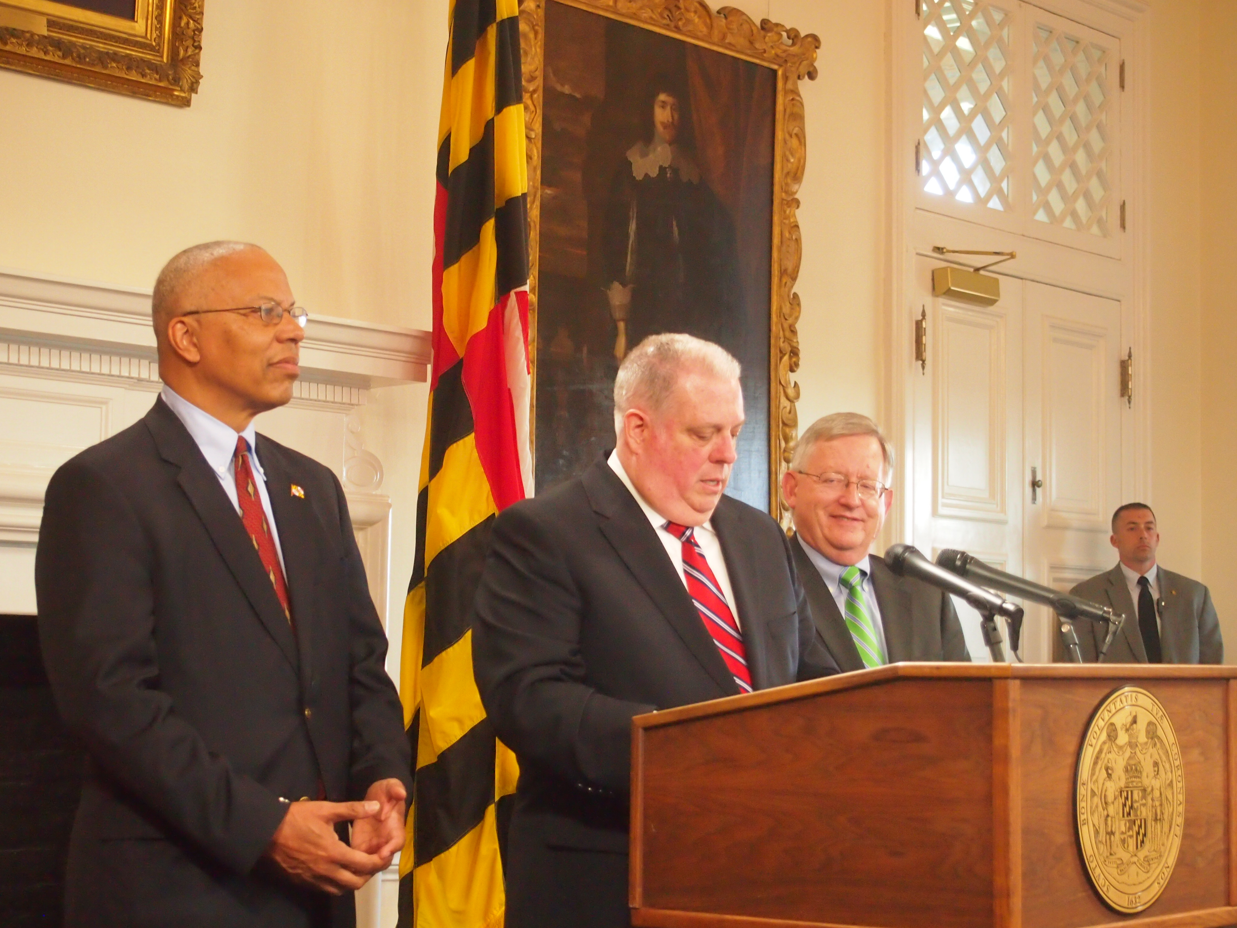 Republican Gov. Larry Hogan, with Lt. Gov. Boyd Rutherford (left) and chief legislative officer Joe Getty (right), speaks to the media about the end of the legislative session and relations with the General Assembly on Tuesday, April 5, 2016. Capital News Service photo by Lexie Schapitl