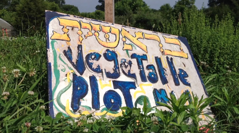 A sign for vegetable plots at Pearlstone Farms