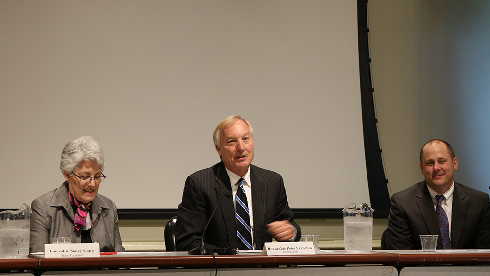 State Comptroller Peter Franchot, D, center, at the Board of Revenue Estimates meeting in Annapolis on Wednesday, September 21, 2016. Andrew Schaufele, director of the board, is to Franchot's left. State Treasurer Nancy Kopp is on Franchot's right. (Capital News Service photo by Vickie Connor)
