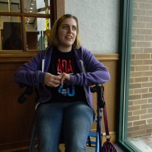 Cheryl Gottlieb, 30, waits for her ride from Maryland Transit Administration's Mobility service in Towson so she can go to an art class. Gottielb has spastic cerebral palsy, which makes it difficult for her to stand for long periods of time or walk without support. Capital News Service photo by Grace Toohey.