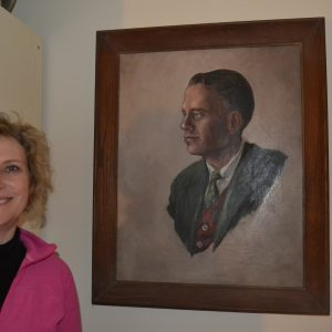 """Alexa Fraser remembers her father as """"a joy of life,"""" like in the young portrait of him in her Rockville home. At 90, he killed himself after suffering from Parkinson's Disease, sparking Fraser to advocate for the right to physician assisted """"death with dignity."""" (Capital News Service photo by Grace Toohey)"""