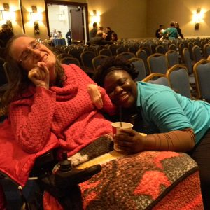 Amanda Lay (left), of Rockville, and her friend and caregiver Portia Acheompong support lobbying day for people with Intellectual and Developmental Disabilities and their advocates in the Loews Hotel in Annapolis on February 19, 2015. Lay is hoping the state will restore the money promised for support services to people with developmental disabilities. She has cerebral palsy. (Capital News Service Photo by Grace Toohey)