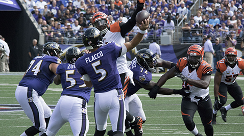 Baltimore Ravens' quarterback Joe Flacco attempts to throw the ball during the Cincinnati Bengals game on Sept. 27, 2015. Photo courtesy by Keith Allison/ Flickr.