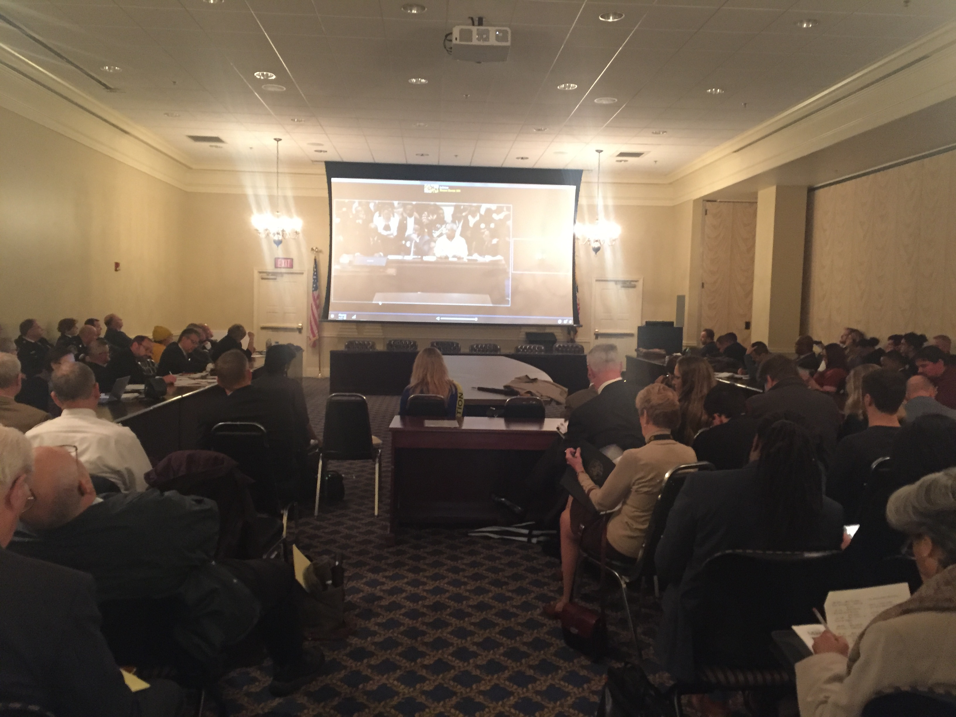Spectators gather in an overflow room to watch a broadcast of the House Judiciary Committee testimony.