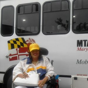 Janice Jackson has used MTA Mobility for 31 years, and she said recently the service has been the worst she has ever seen it. Jackson, who is an incomplete quadriplegic, uses the alternative transportation service to go to work, meetings, meet friends and go shopping, which is why it's reliability is crucial for her and thousands in the area. Capital News Service photo courtesy of Kathy Owens.