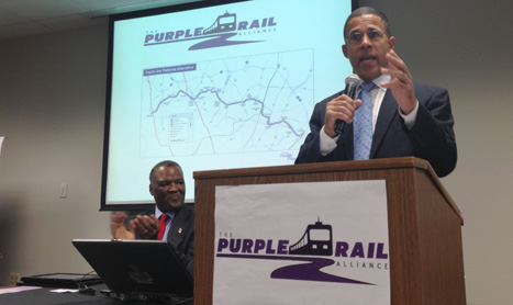 """Lt. Gov. Anthony Brown expresses his approval for the Purple Line as Prince George's County Executive Rushern Baker applauds. """"Maryland is neither a blue state nor a red state. We are a purple state,"""" said Brown at a real estate agency in Greenbelt on Thursday."""