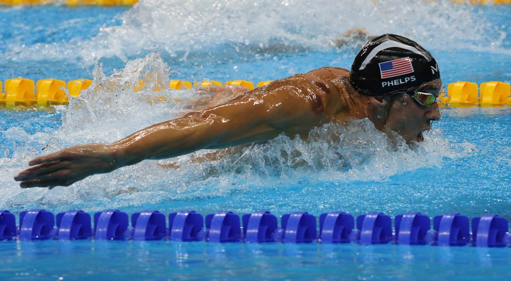 Olympic champion Michael Phelps of United States swimming the Men's 200m butterfly at Rio 2016 Olympic Games. Leonard Zhukovsky / Shutterstock.com