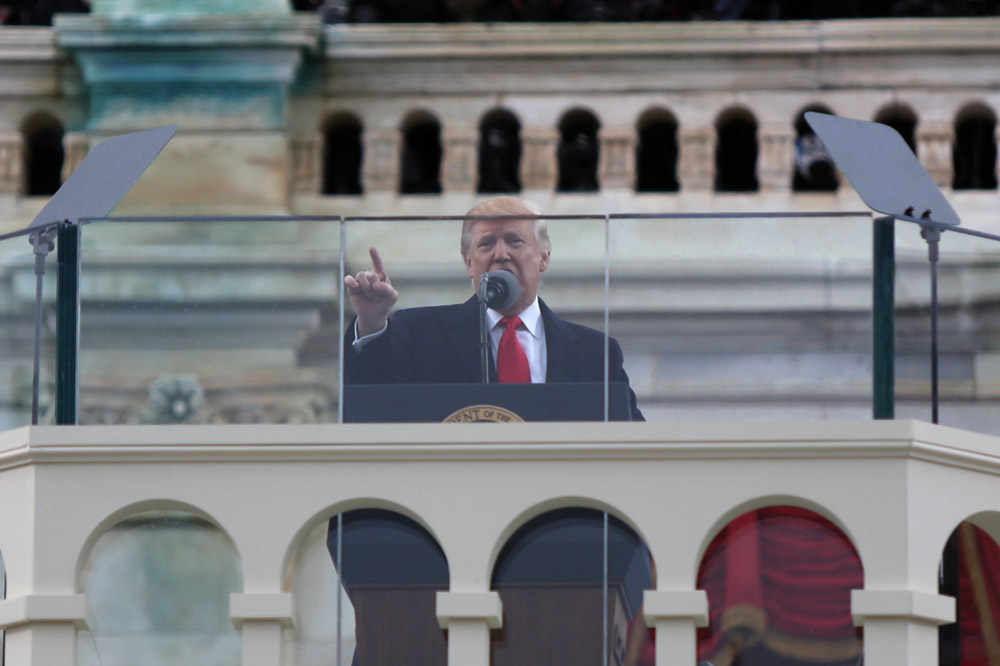 President Donald J. Trump gestures while giving his speech after being sworn in at the inauguration on the temporary inaugural platform on the steps of the Capitol in Washington D.C. Capital News Service Photo by Hannah Klarner.
