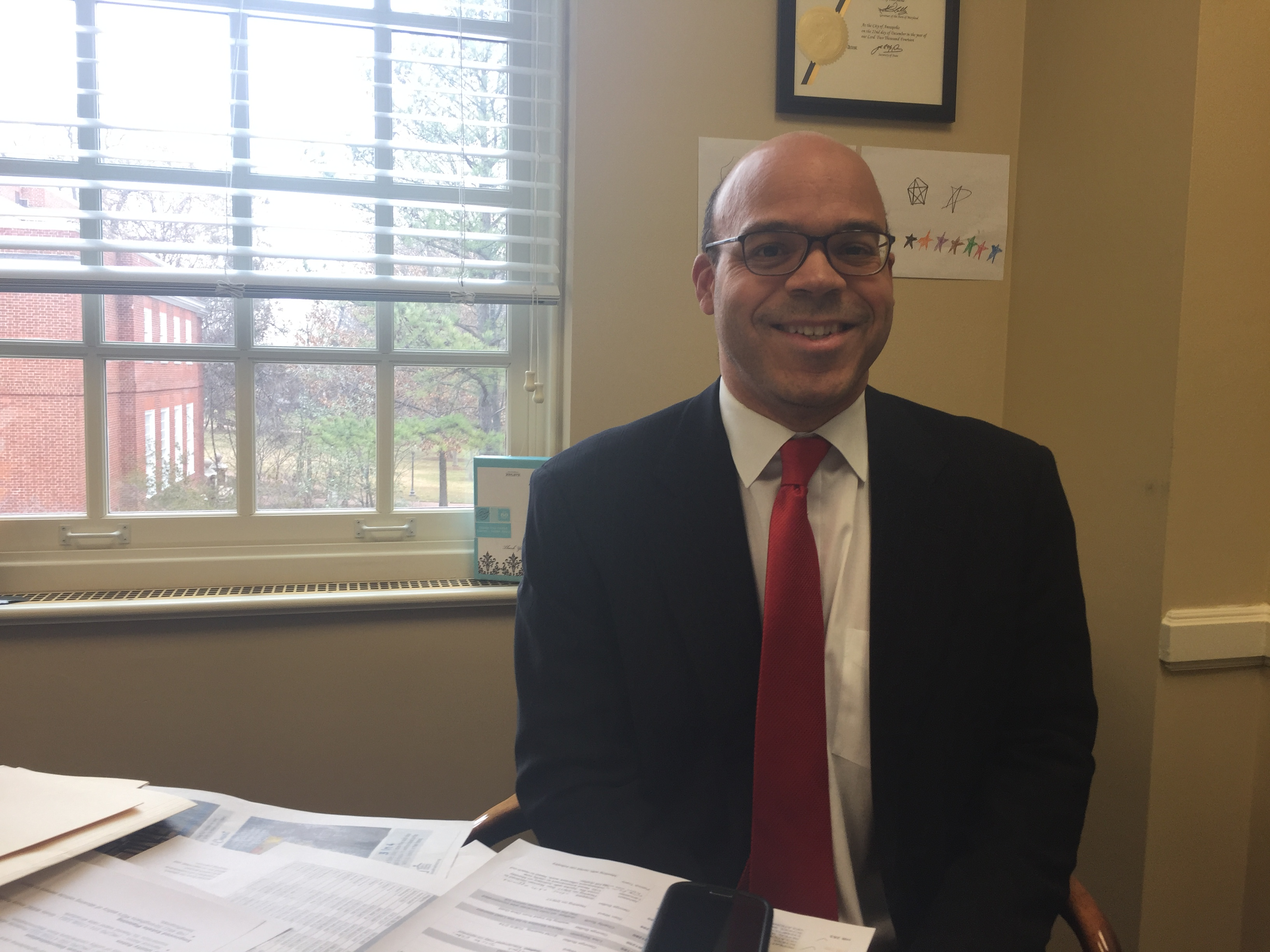 Delegate Al Carr, D-Montgomery, in his office in Annapolis. Carr is sponsoring two bills in the 2017 session related to cameras on the outside of school buses. The number of motorists who drive around stopped buses has been increasing in Montgomery County. (Capital News Service photo by Cara Newcomer)