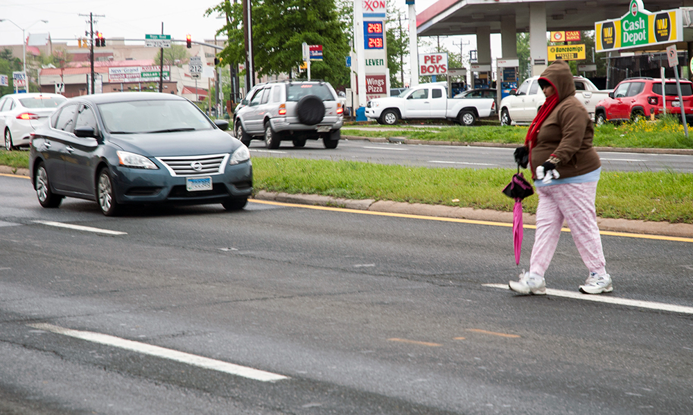 The high pedestrian accident toll has led to few safety improvements on dangerous stretches of University Boulevard like this one in Langley Park. Yet when students were killed close to the University of Maryland campus nearby, the state lowered the speed limit, added a pedestrian signal, installed a median fence and increased use of speed cameras. (Capital News Service photo by Rebecca Rainey)