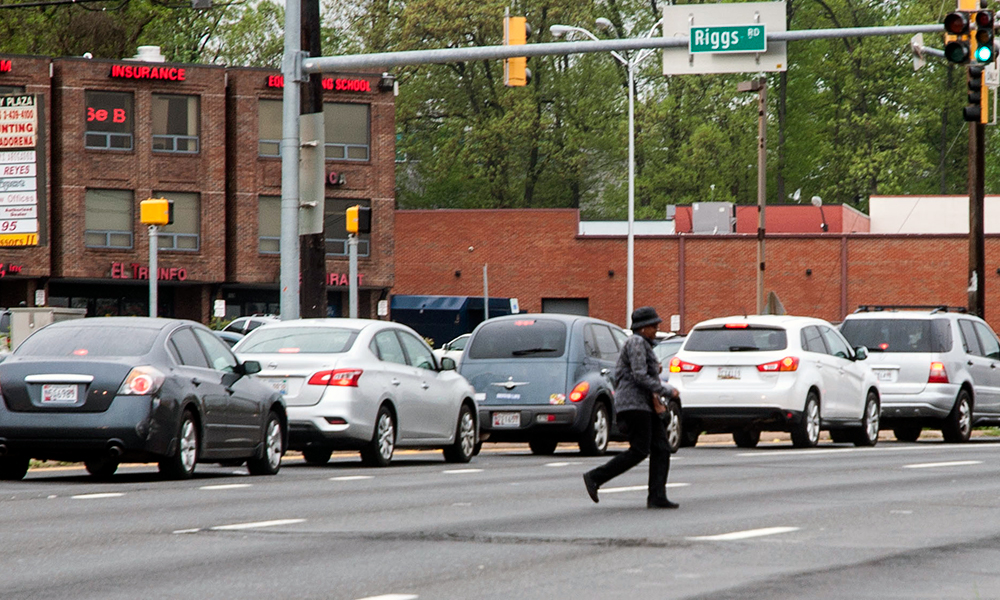 About half the pedestrian fatalities on University Boulevard in Langley Park since 2009 occurred near the busy intersection of University and Riggs Road. (Capital News Service photo by Rebecca Rainey)