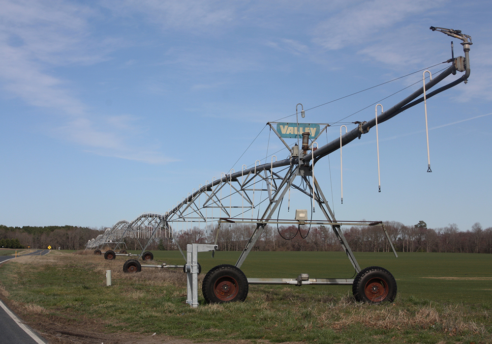 A field irrigator awaits planting season in Dorchester County. Depressed grain prices are making it harder for Eastern Shore farmers to make ends meet. (Photo by J.F. Meils/Capital News Service)