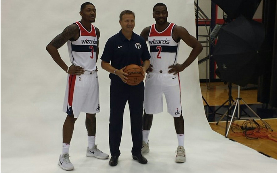 Washington Wizards players Bradley Beal (left) and John Wall (right) pose with coach Scott Brooks (center) at media day on Monday, Sept. 25, 2017. Photo by Adam Zielonka/Capital News Service.
