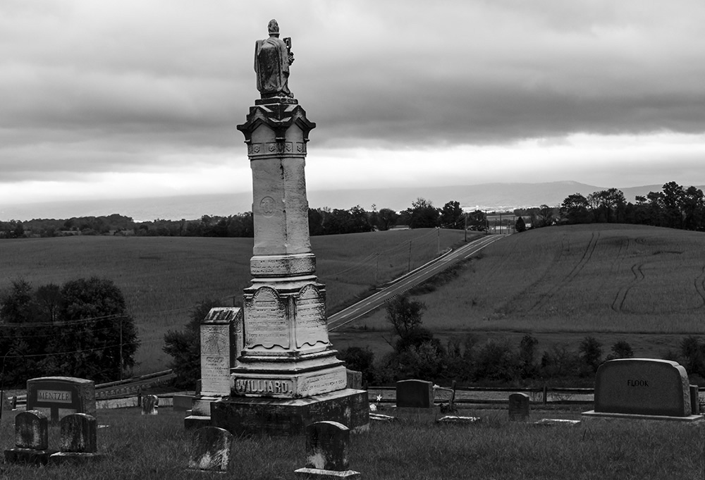 "The cemetery in Burkittsville, Md., with a backdrop of picturesque rolling hills on Thursday, October 12, 2017. The cemetery was featured in the beginning of ""The Blair Witch Project."" (Alex Mann/Capital News Service)"