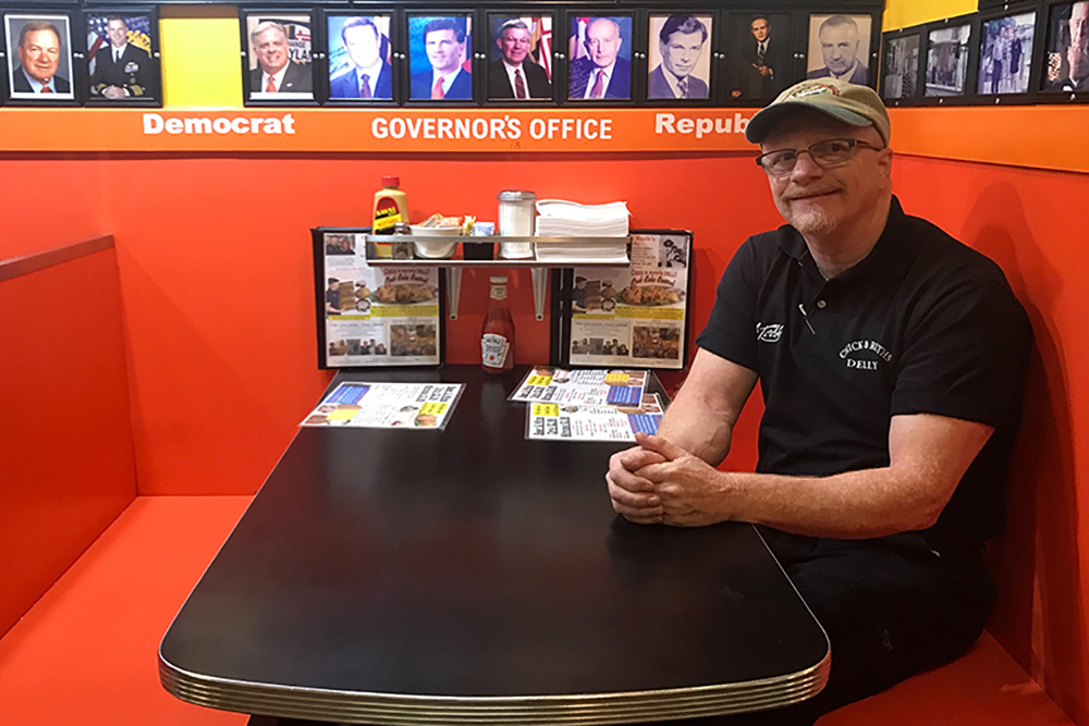 ANNAPOLIS, Md. -- Ted Levitt poses for a photo on the morning of Tuesday, Sept. 19, 2017, in the acclaimed governor's booth inside Chick & Ruth's Delly (Jess Feldman/Capital News Service).