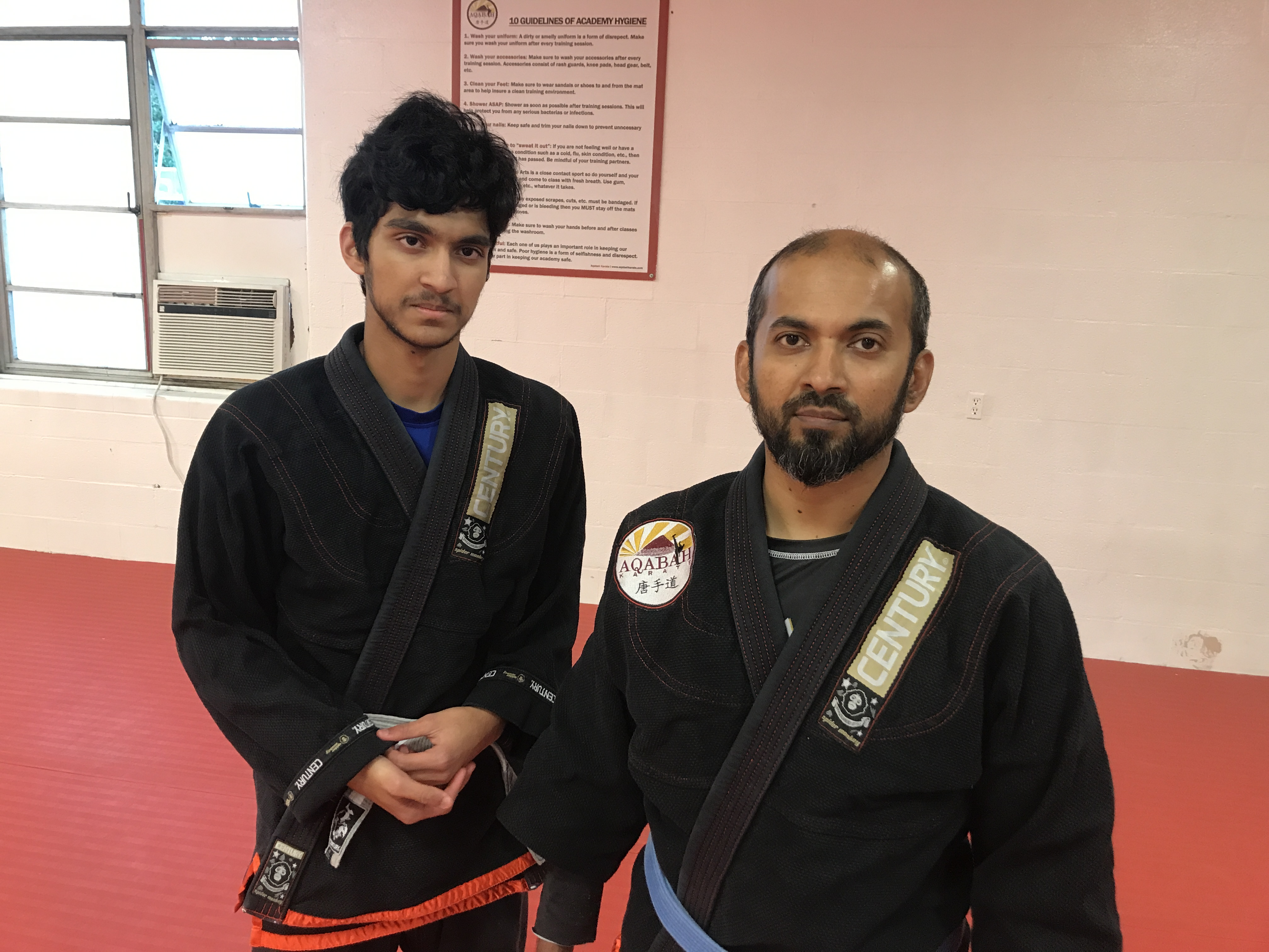 Muhib Rahman and his son Talha Muhib at Aqabah Karate on Thursday, October 26, 2017. Rahman is an instructor at Aqabah Karate in College Park and Talha is one of his students. (Chris Miller/Capital News Service)