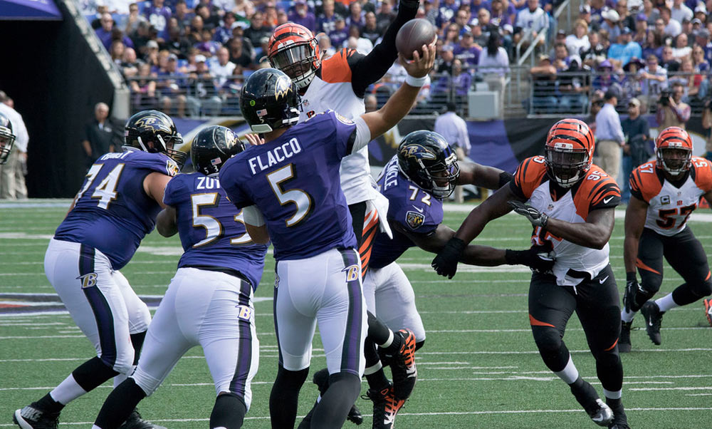 Joe Flacco attempts a pass against the Cincinnati Bengals in 2015. Capital News Service found that Flacco has been one of the worst passers in the NFL this season. Keith Allison/Flickr