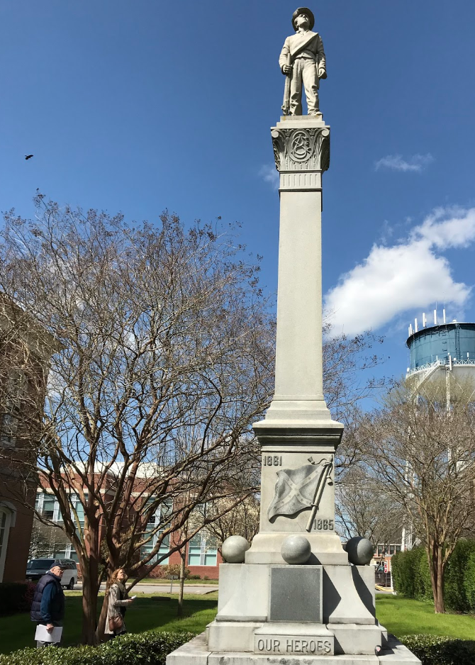 "Erected in 1911, the 30-foot granite monument stands in Elizabeth City, N.C. The south side features a Confederate battle flag with the words ""Our Heroes."" Capital News Service photo."