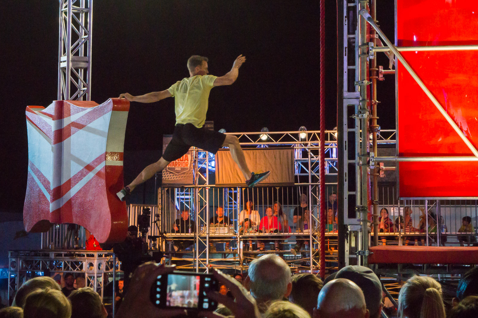 """Geoff Britten leaps from one obstacle to the next during his in Season 7 of """"American Ninja Warrior."""" (Photo courtesy of Geoff Britten)"""