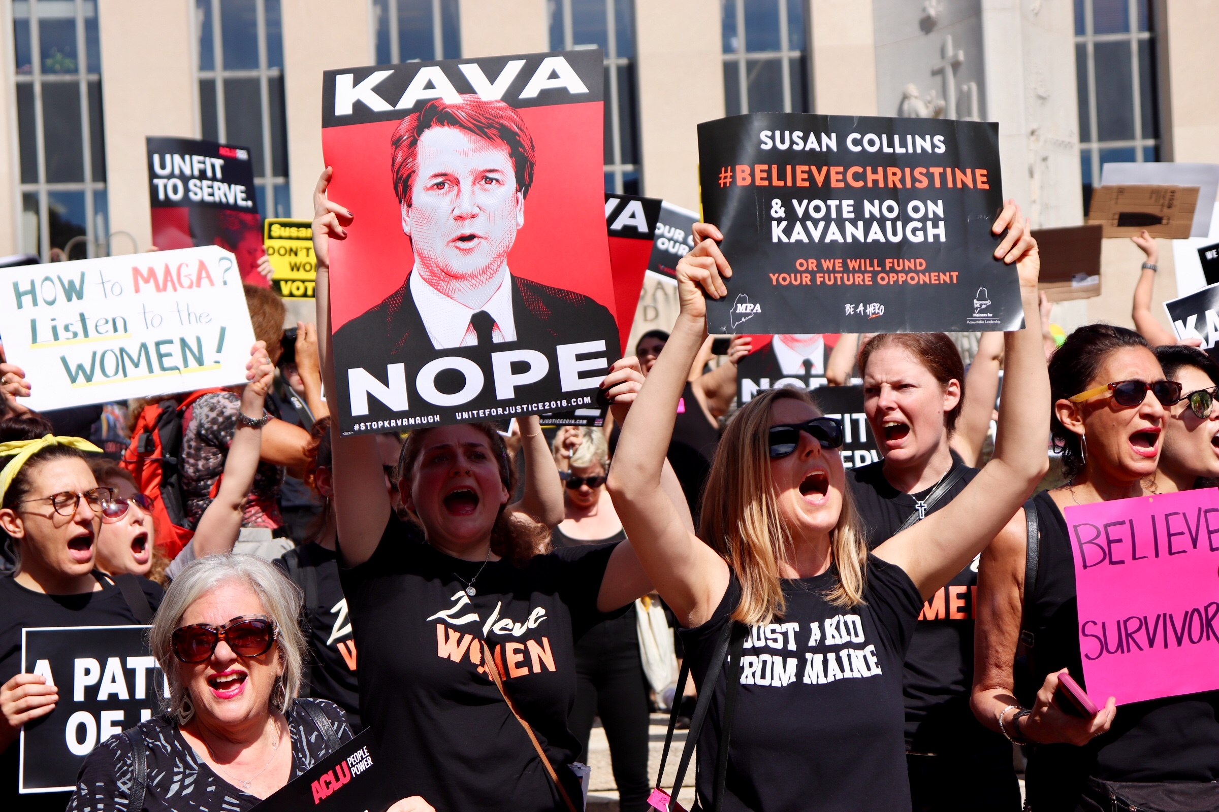 WASHINGTON - Protesters urged Congressman Collins to vote no on Kavanaugh (Albane Guichard/Capital News Service)