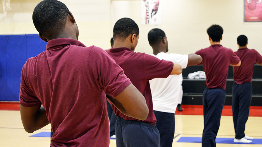 Boys at the Baltimore City Juvenile Justice Center practice yoga to work on mindfulness habits as they wait for placement or trials on Sept. 25, 2018. (Courtesy of Eric Solomon)