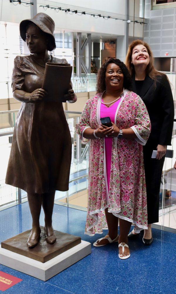 WASHINGTON - Amanda Matthews and Penny Allison Lockhart standing proud next to Alice Allison Dunnigan's newly inaugurated statue. (Albane Guichard/Capital News Service)
