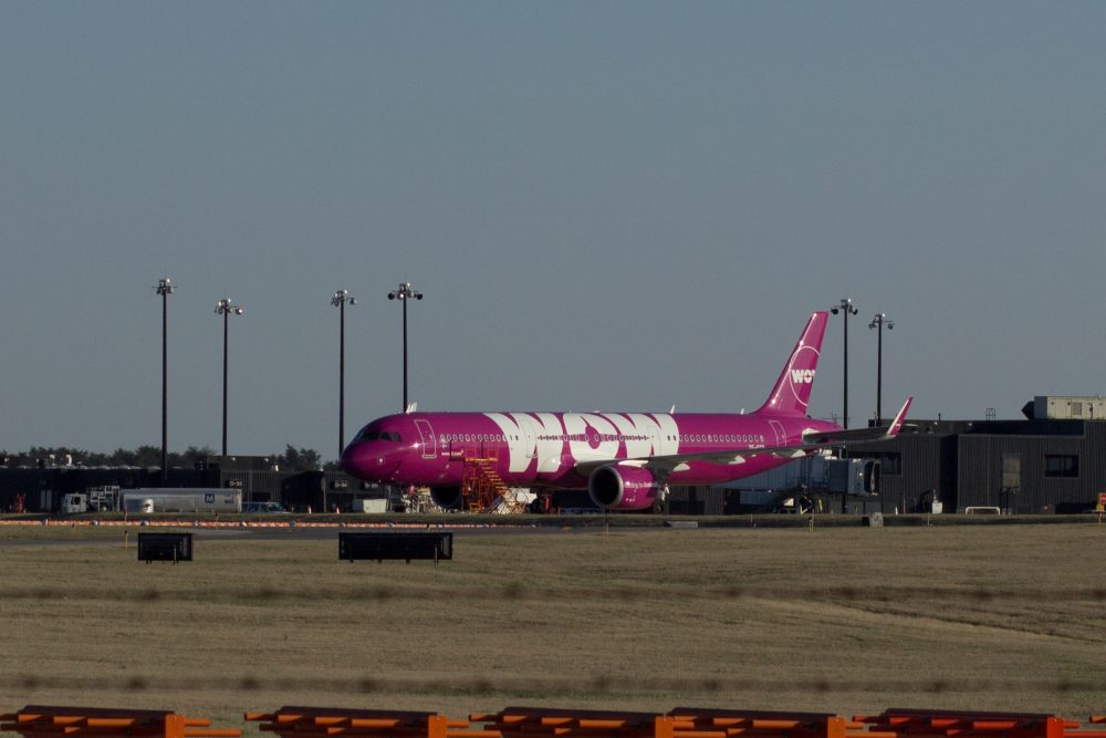 Wow Air jetliner sits idle on the tarmac of BWI Airport