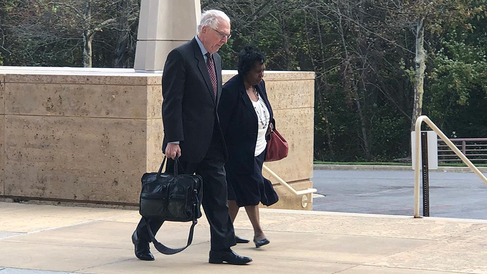 Former Maryland Delegate Tawanna Gaines, D-Prince George's, walks with her attorney, William Brennan Jr., toward the U.S. District Court in Greenbelt, Maryland, on Oct. 17, 2019, to appear for her arraignment on a federal wire fraud charge. Capital News Service photo by Elliott Davis.