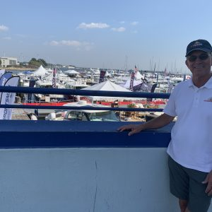 Paul Jacobs, president of the Annapolis Boat Shows, looks out at his fellow set-up crew setting up in hotter weather conditions.
