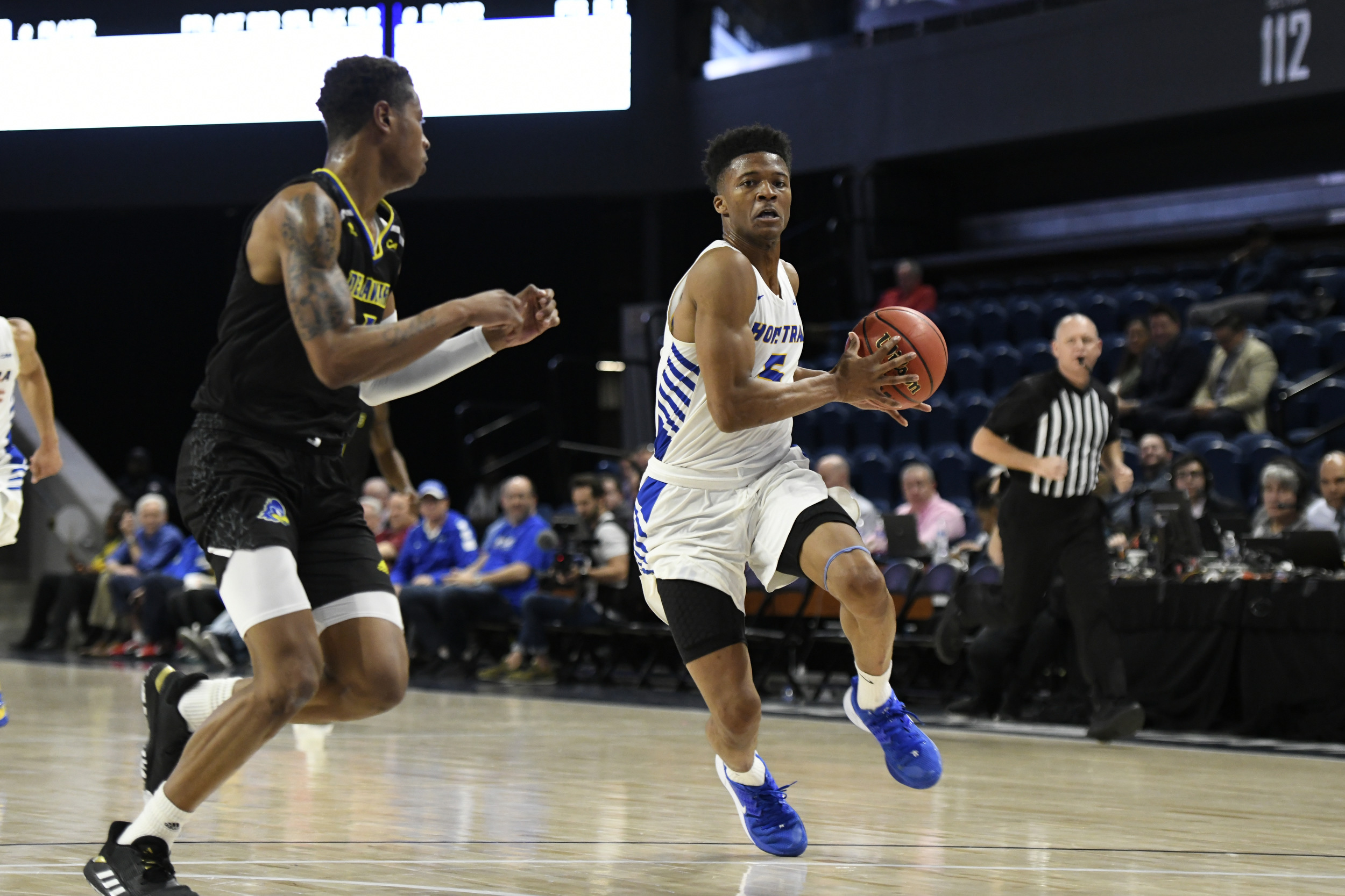 Hofstra guard Eli Pemberton drives against the Delaware defense in the Colonial Athletic Association Men's Basketball Tournament semifinal in Washington. Pemberton led the Pride with 24 points. (Photo: Rafael Suanes/CAA)