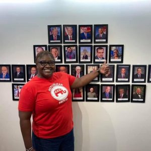 Del Thiam in front of wall of conservative state reps