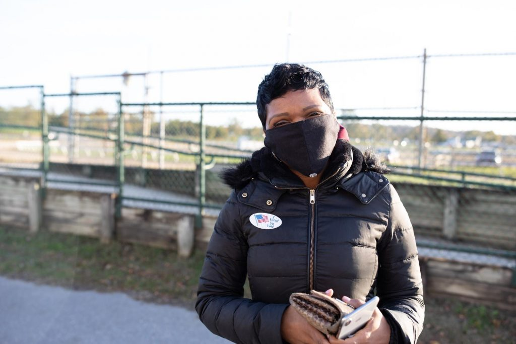 LaRhonda Hill Usher, 48, outside The Show Place Arena, said she voted for Joe Biden because she believes the scientists and doctors. (Photo by Brittany N. Gaddy)