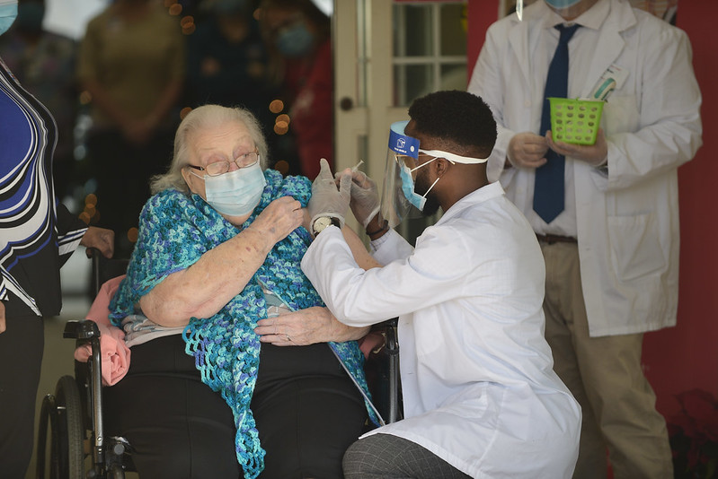 A COVID-19 vaccine is administered to a nursing home resident December 23, 2020. (Maryland GovPics)