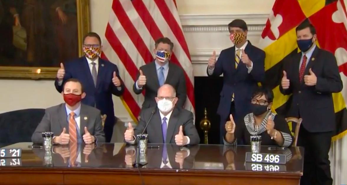Gov. Larry Hogan, R, Senate President Bill Ferguson, D-Baltimore, and House Speaker Adrienne Jones, D-Baltimore, sign the RELIEF act into law on Jan 15 in Annapolis. (Photo Screenshot: Catherine Scott/Capital News Service)
