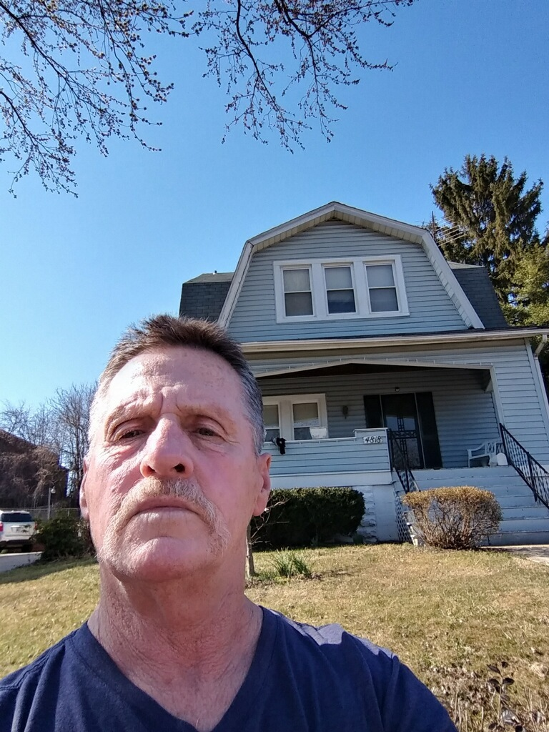Raymond Thompson, pictured in front of his Baltimore City residence, was once at risk of losing his home to the upcoming tax sale due to lost paperwork.