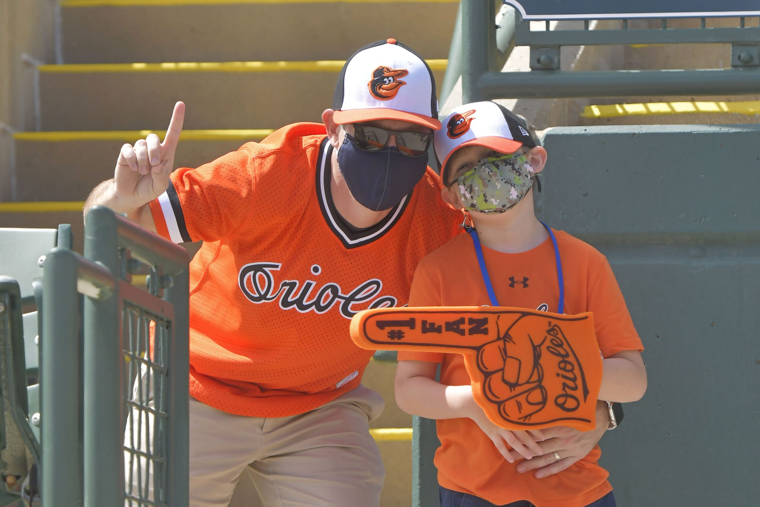 Orioles fans pose for a picture at a spring training game in Sarasota, Florida, on March 10 where a mask mandate was enforced. (Photo credit: Baltimore Orioles.)