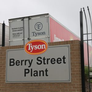 A Tyson Berry Street Plant sign in front of the Springdale, Arkansas, Tyson parking lot for hauling chicken products, April 20, 2021. The Berry Street location had more than 400 COVID-19 cases among the workers, the highest number cases across Arkansas poultry plants. (Photo by Abby Zimmardi)