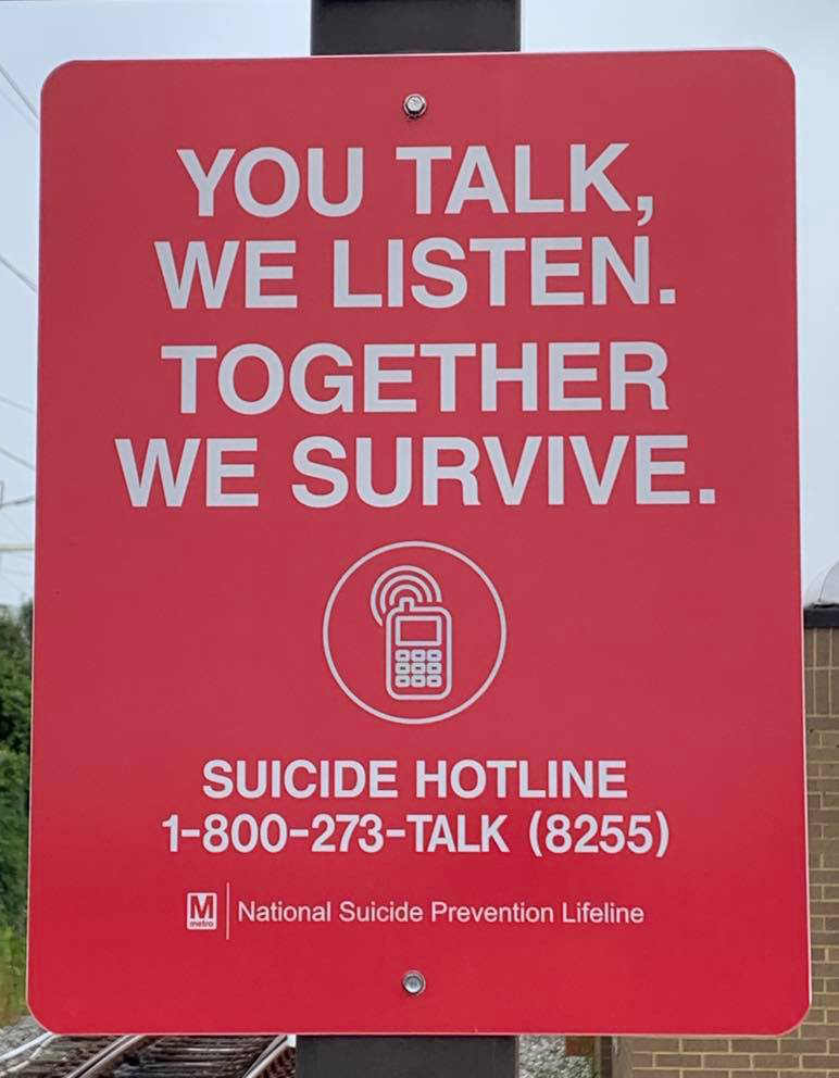 A sign at the end of the New Carrollton Metro Station showing the National Suicide Prevention Lifeline on Sept. 18, 2021. Capital News Service photo by Kelly Livingston.